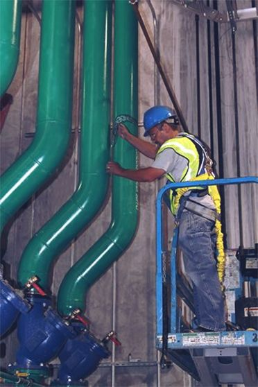 McNeil Industry Working On Refrigeration Compressor
